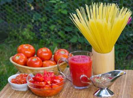 Image of tomato, slices, juice, ketchup for pasta Stock Photo