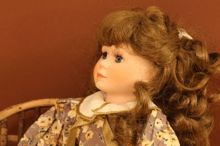 Porcelain doll face with beautifull curly hair Stock Photo - 4184791
