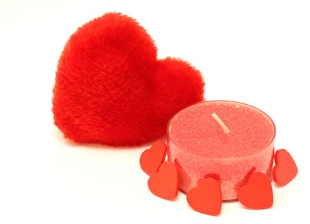 candlestick and red  hearts on white background photo