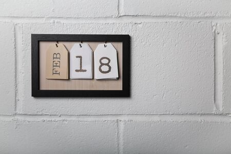 Wall Hanging Calendar in a Picture Frame Showing February 18