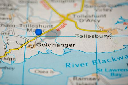 Blue Map Pin on Paper Map Showing Goldhanger