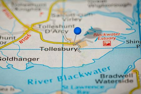 Blue Map Pin on Paper Map Showing Tollesbury