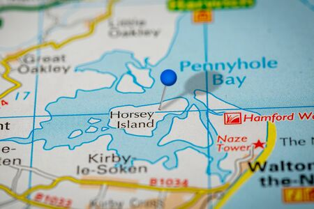 Blue Map Pin on Paper Map Showing Horsey Island
