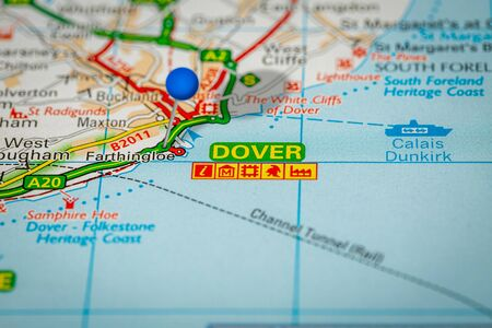 Blue Map Pin on Paper Map Showing Dover
