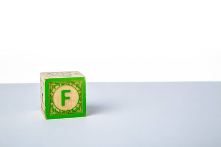 Childrens Wooden Alphabet Block Showing the Letter F
