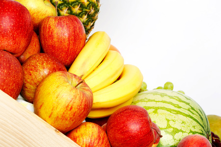 Basket of several fresh fruits, closeup, white background