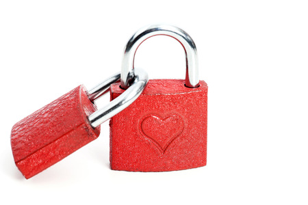Two red padlocks with with hearts on them isolated, white background Stock Photo