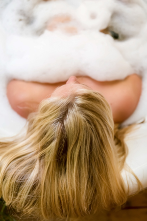 Woman taking a bath, view from the back, blonde air Stock Photo
