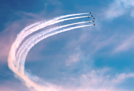 A few parade planes, flying in formation, beautiful sky