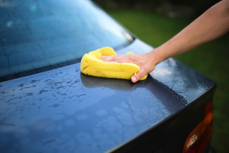 valet: Washing a car with a sponge Stock Photo