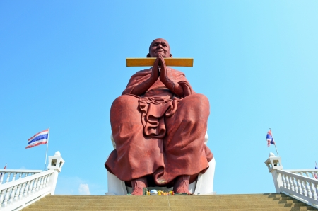 Clergy giant statue at thailand photo