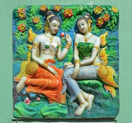 Two ladys on the wall of Thai spa photo