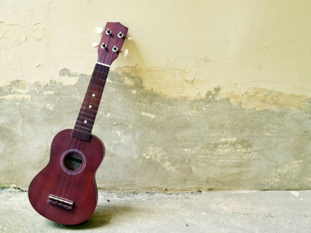 Ukulele on cement background photo