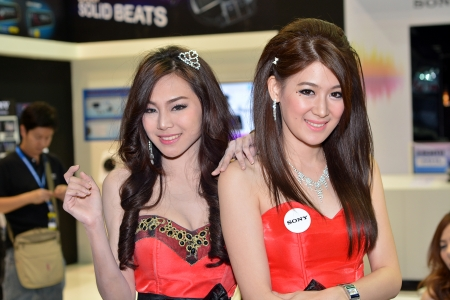 NONTHABURI , THAILAND - NOVEMBER 30  Unidentified female presenter at Sony booth in THE 30th THAILAND INTERNATIONAL MOTOR EXPO 2013 on November 30, 2013 in Nonthaburi, Thailand