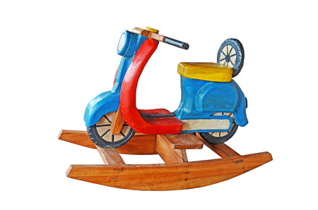 Motorcycle wood toy on white  photo