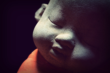Close up of monk doll