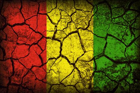 Guinea flag pattern on the crack soil texture ,retro vintage style