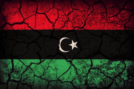 Libya flag pattern on the crack soil texture ,retro vintage style
