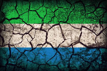 Sierra Leone flag pattern on the crack soil texture ,retro vintage style photo