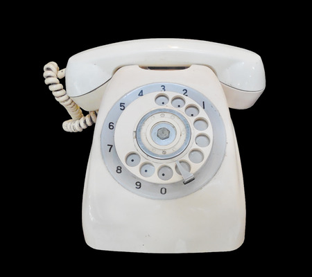 Vintage telephone on black background photo