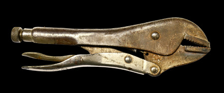 old locking pliers on a black background photo
