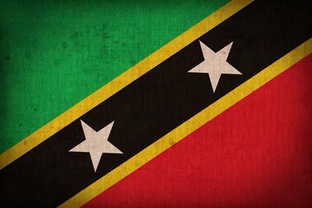 sain: Sain Kitts and Nevis flag pattern on the fabric texture ,retro vintage style