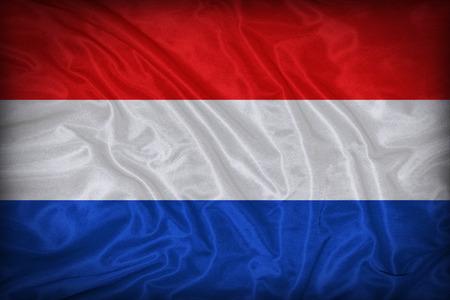 Nederland vlag patroon op de stof textuur, vintage stijl Stockfoto - 31998264
