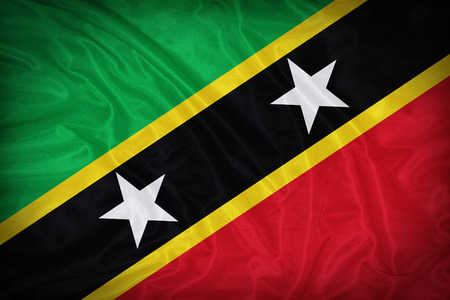 sain: Sain Kitts and Nevis flag pattern on the fabric texture