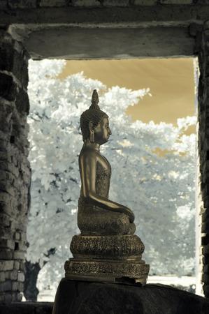 Sculpture of Buddha at Ayutthaya Historical Park, Thailand taken in Near Infrared photo