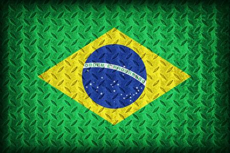 Brazil flag pattern on the diamond metal plate texture ,vintage style photo