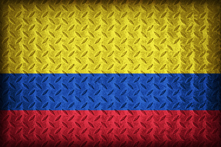 Colombia flag pattern on the diamond metal plate texture ,vintage style photo