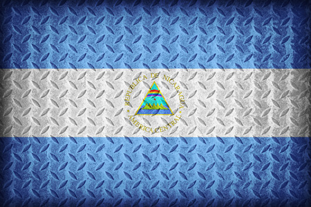 Nicaragua flag pattern on the diamond metal plate texture ,vintage style photo