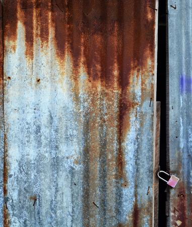 corrugated iron: old zinc door,rusty corrugated iron metal Stock Photo