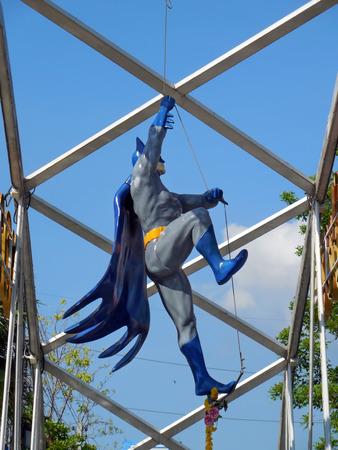 AYUTTAYA,THAILAND - MAY 05, 2014 : Batman model on slings at Thung Bua Chom floating market