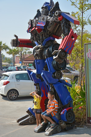 AYUTTAYA,THAILAND - DECEMBER 28, 2013 : The Replica of Optimus Prime robot made from iron part of a Car display at Thung Bua Chom floating market