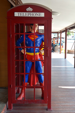 AYUTTAYA ,THAILAND- DECEMBER 28, 2013: Superman model standing in a phone booth  at Thung Bua Chom floating market
