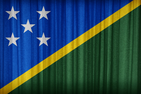 micronesia: Solomon Islands flag pattern on the fabric curtain,vintage style Stock Photo