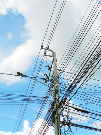 isolator insulator: Power lines and electricity pylon on the blue sky