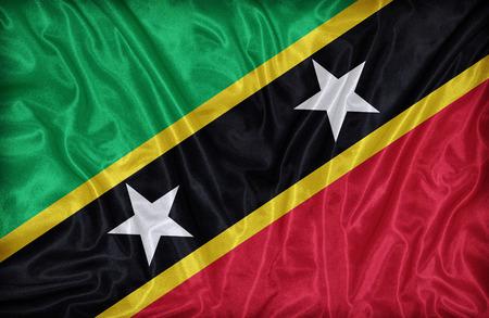 sain: Sain Kitts and Nevis flag pattern on the fabric texture ,vintage style