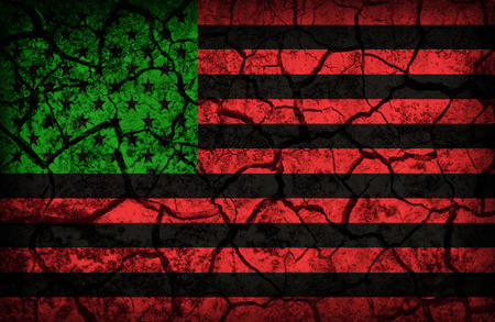 cleavage: African America Resistance and Solidarity flag pattern on the crack soil texture ,retro vintage style Stock Photo