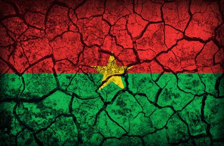 cleavage: Burkina Faso flag pattern on the crack soil texture ,retro vintage style