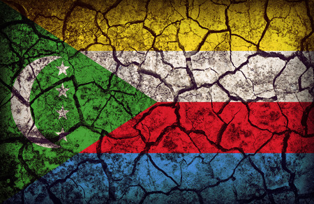 cleavage: Comoros flag pattern on the crack soil texture ,retro vintage style