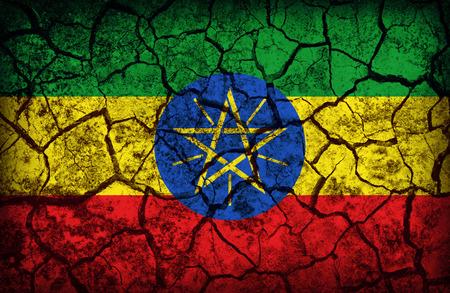 cleavage: Ethiopia flag pattern on the crack soil texture ,retro vintage style
