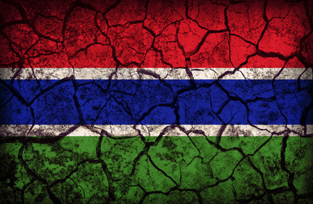 cleavage: Gambia flag pattern on the crack soil texture ,retro vintage style Stock Photo