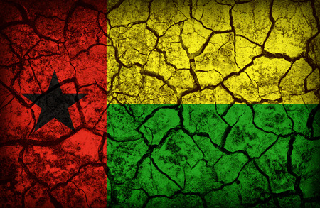 cleavage: Guinea Bissau flag pattern on the crack soil texture ,retro vintage style