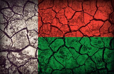 Madagascar flag pattern on the crack soil texture ,retro vintage style