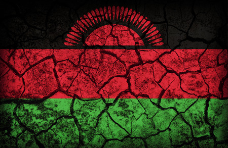 cleavage: Malawi flag pattern on the crack soil texture ,retro vintage style