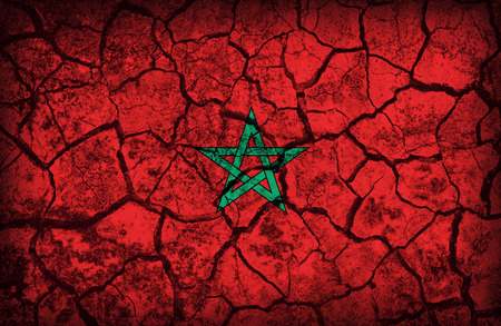 cleavage: Morocco flag pattern on the crack soil texture ,retro vintage style Stock Photo