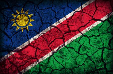 cleavage: Namibia flag pattern on the crack soil texture ,retro vintage style Stock Photo