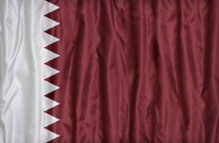 retrospective: Qatar flag pattern on the fabric texture , vintage style